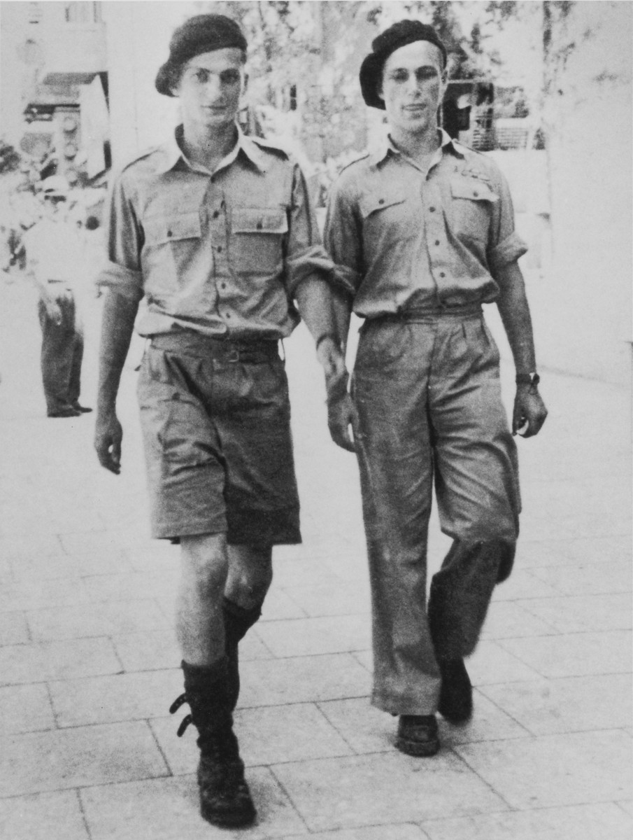 Former Exodus 1947 crew members Bernard Marks and Benjamin Forman, walk down a Tel Aviv street after making their first jump as Haganah paratroopers.
