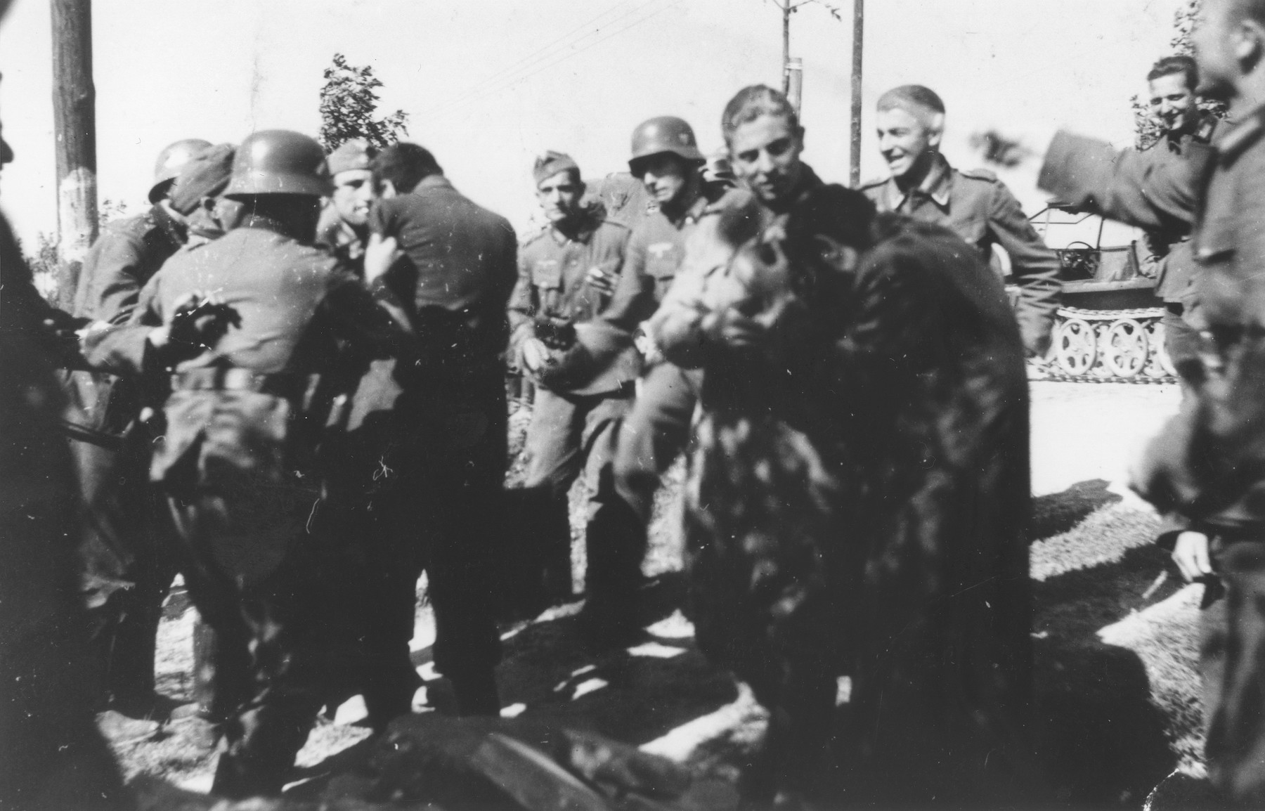 Jews are beaten by German soldiers in a town 15 km. south of Lodz during the first weeks of the German invasion.