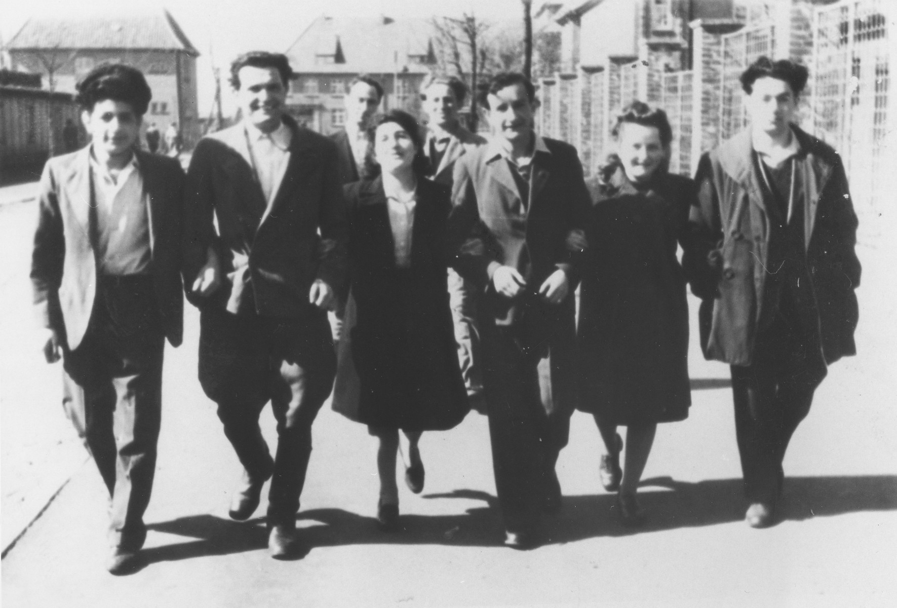 Former passengers of the Exodus 1947 and friends from the Emden displaced persons camp stroll along a city street.