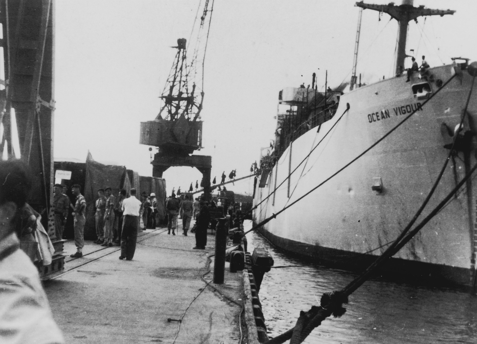 "British soldiers wait on the dock in Haifa harbor to begin transferring the passengers of the illegal immigrant ship, Exodus 1947, to the British ""comfort ship,"" Ocean Vigour."