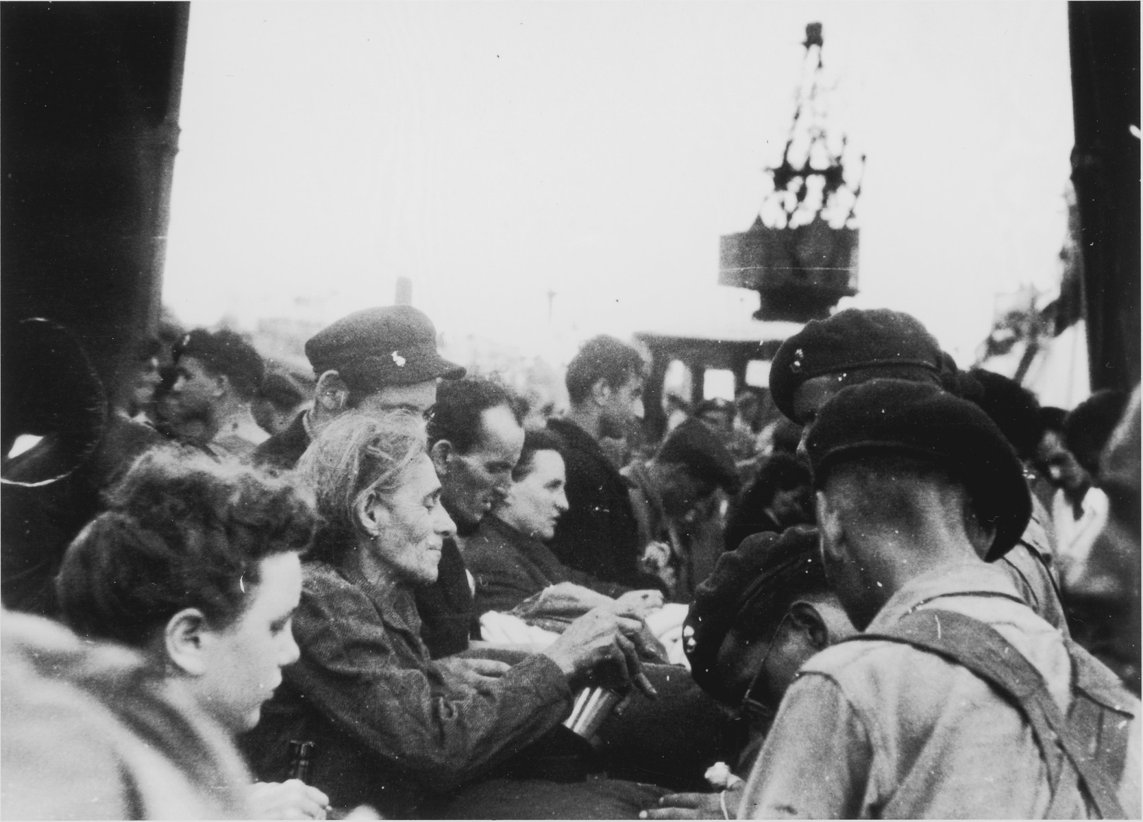 Passengers of the Exodus 1947 have their papers checked by British soldiers on the pier in Haifa.