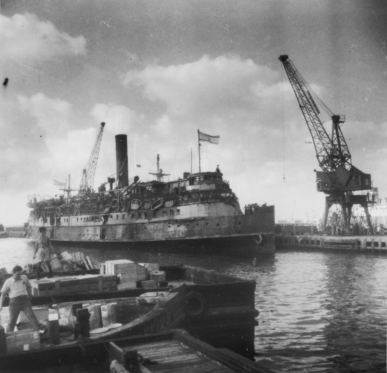 The battered illegal immigrant ship, Exodus 1947, berths in Haifa harbor.