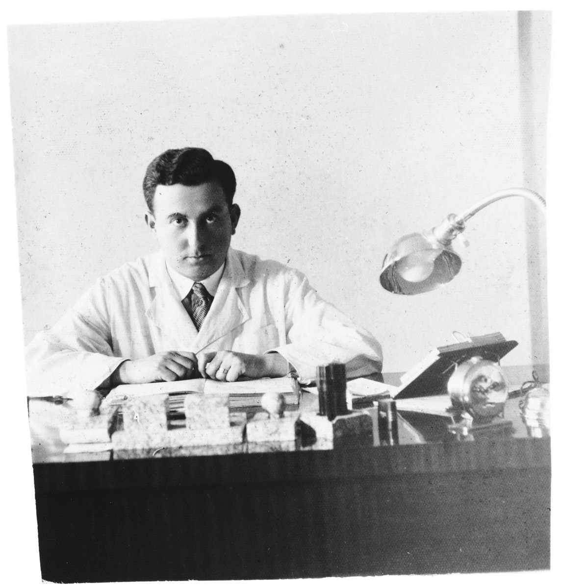 Dr. Aaron Shafer, an opthamologist, sits at his desk in Rovno.