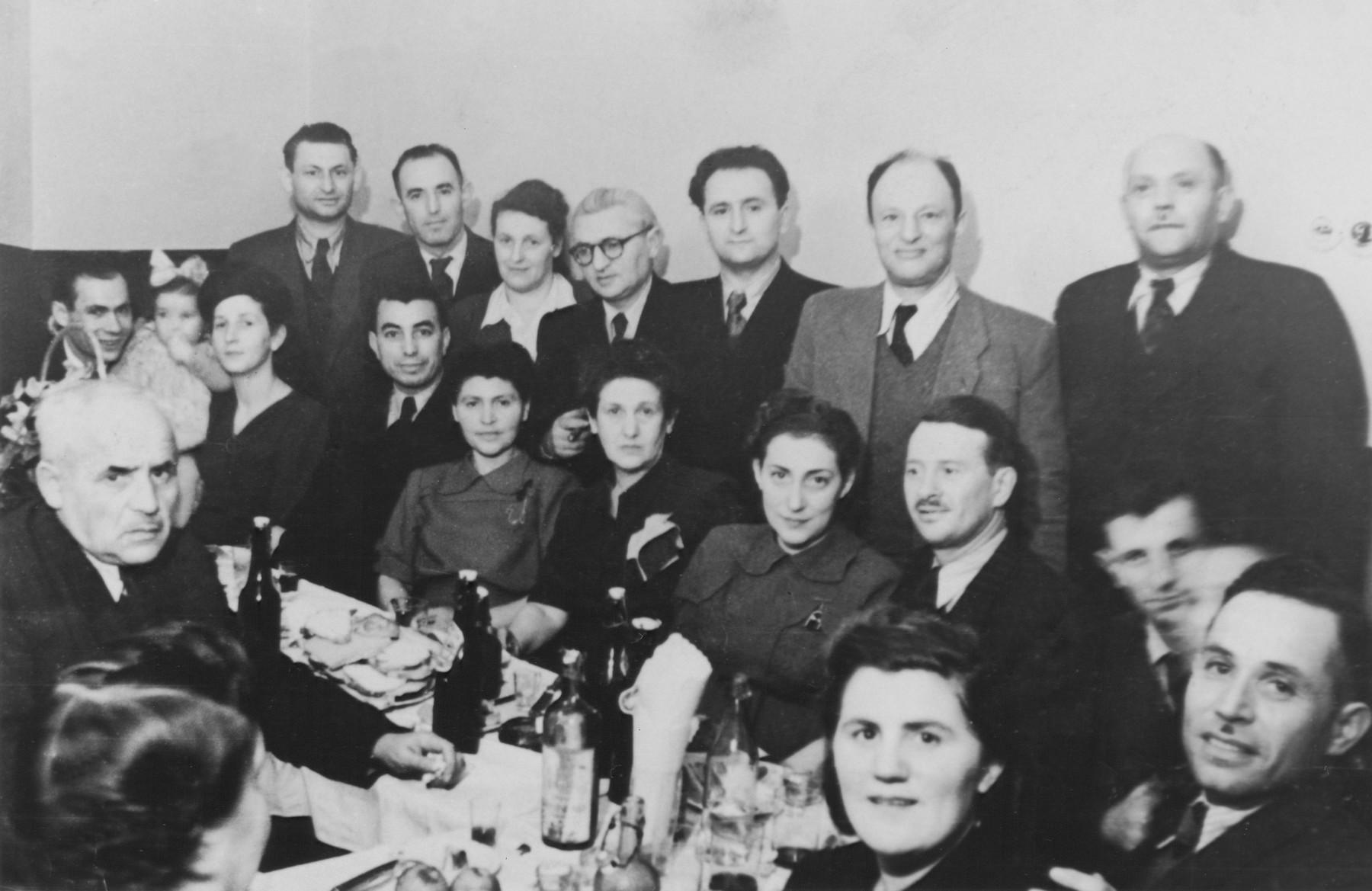 Jewish survivors froem Skierniewice at a social gathering in Lodz.
