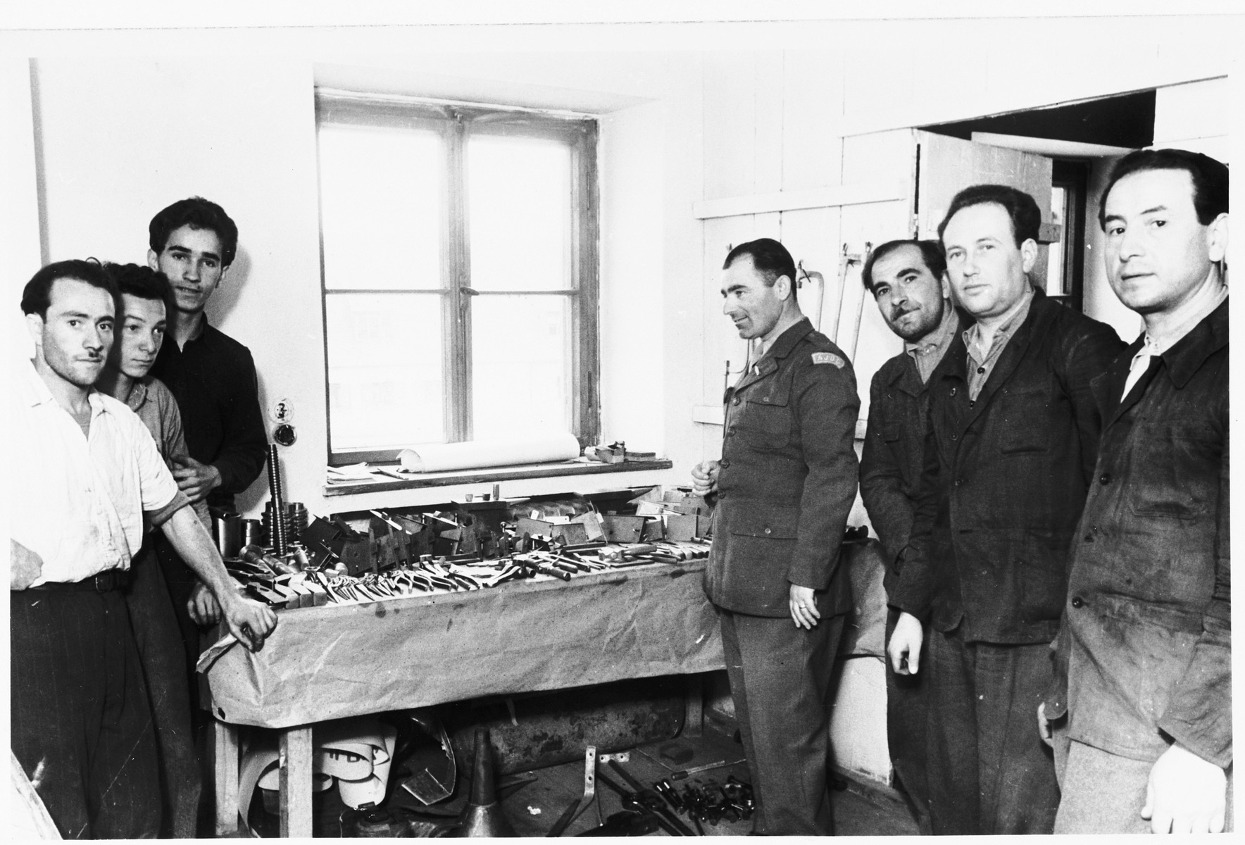 Isaak Libstug visits a workshop in the Foehrenwald displaced persons camp.
