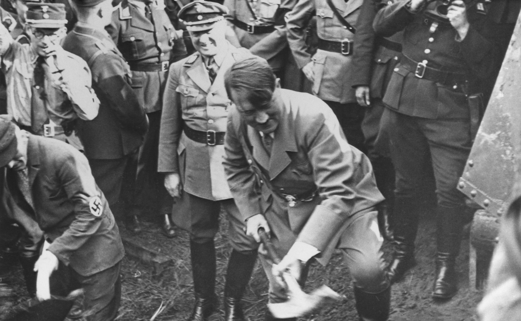 Adolf Hitler wields a spade at the groundbreaking ceremony for construction of the first section of the autobahn from Frankfurt am Main to Darmstadt on September 23, 1933 in Frankfurt.    Standing directly behind Hitler is Jakob Sprenger, Gauleiter of Hessen-Nassau. The picture postcard is addressed to Alfred Lutz in Possneck and is dated September 28, 1933.