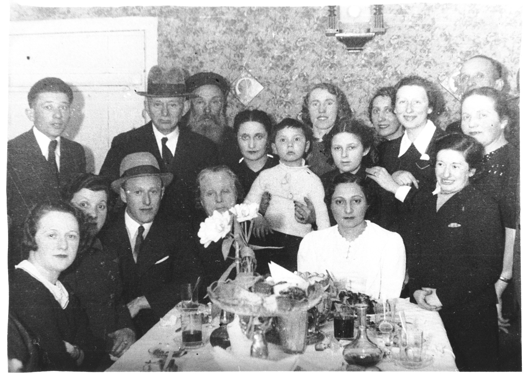 The Gertner family gathers around a table to celebrate the wedding of Josef and Peppa Gertner.