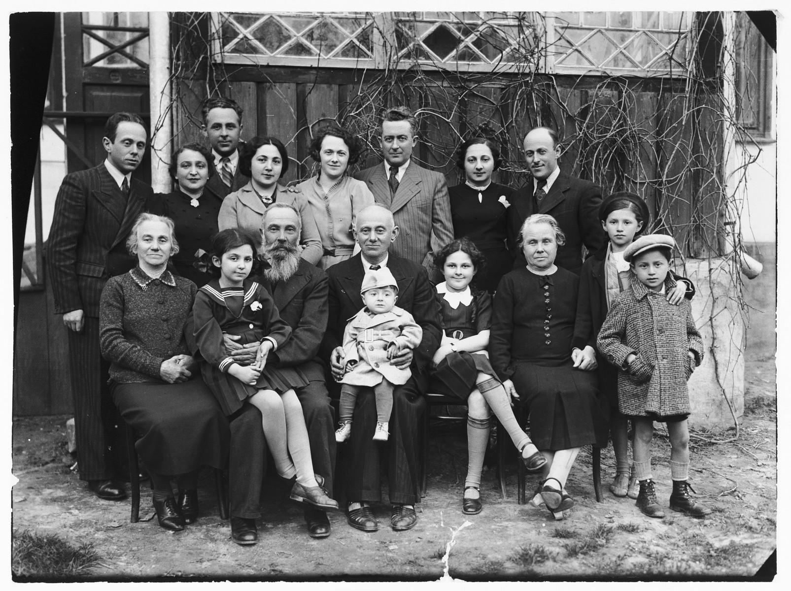 Portrait of the extended Sztejnsznajd and Gertner families taken on Passover shortly before the family of Josef Sztejnsznajd departed for America.  Pictured left to right.  Front row: Sara Teresz, Lila Garber, Uncle Avraham, Moshe Gertner, Chaim Sztejnsznajd, Sara Sztejnsznajd, Cipora Gertner, two Weinstein children.  Back row: Avraham Gertner, Baila Sztejnsznajd, Josef Sztejnsznajd, Peppa Garber, Goldie Sztejnsznajd, Czala Garber, Peppa Gertner, and Josef Gertner.