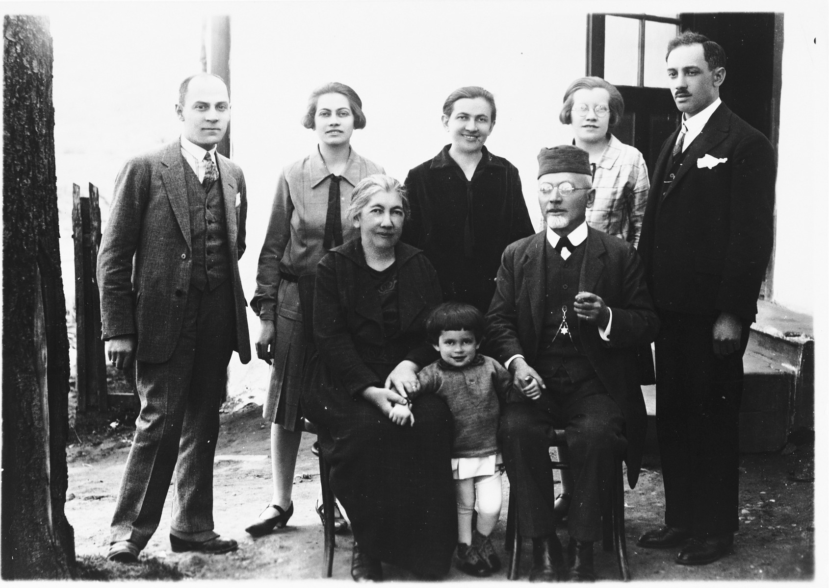 Group portrait of membes of the Deutsch family in front of their home in Ludbreg, Croatia.  Pictured in the front row from left to right are: Katarina Deutsch, Zdenka Apler and Rabbi Leopold Deutsch.  Second row: Rudi Apler, Blanka Apler, Giza Deutsch, Silva Deutsch and Erne Deutsch.