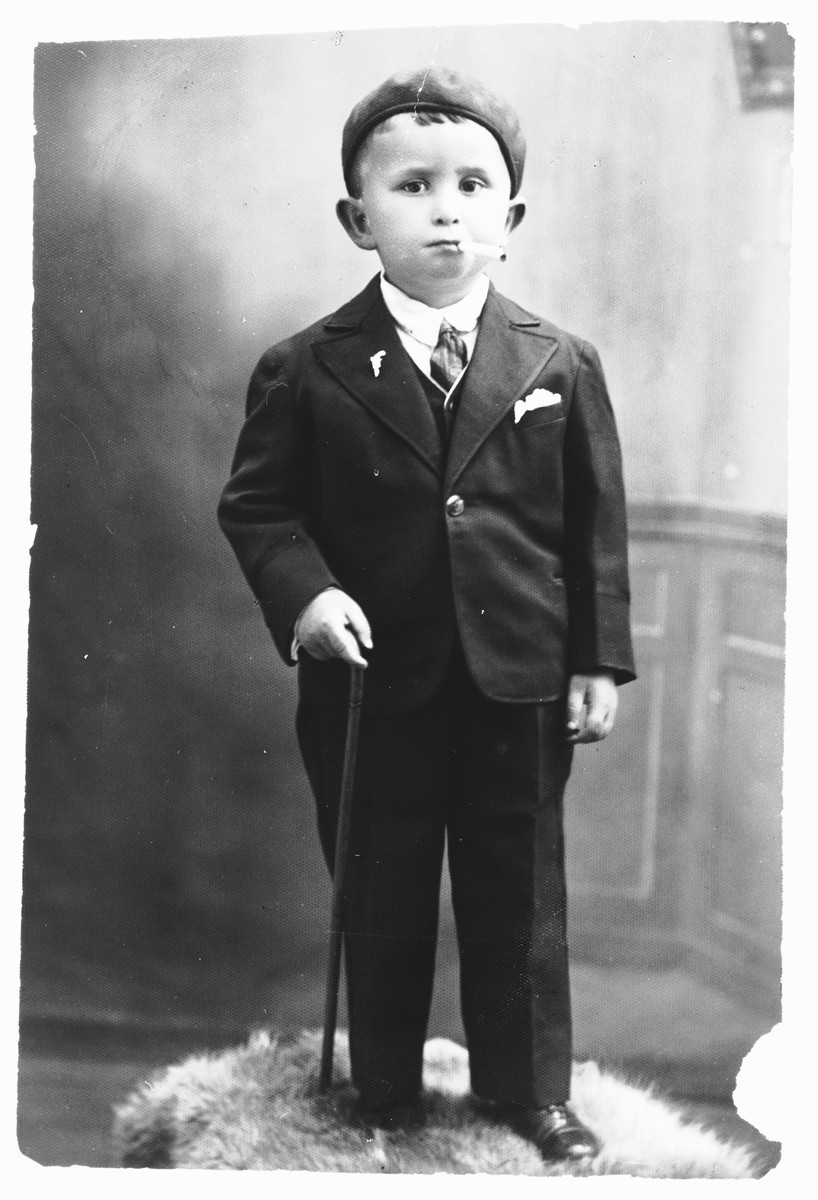 Portrait of Ronald, a young boy in France, smoking a cigarette.