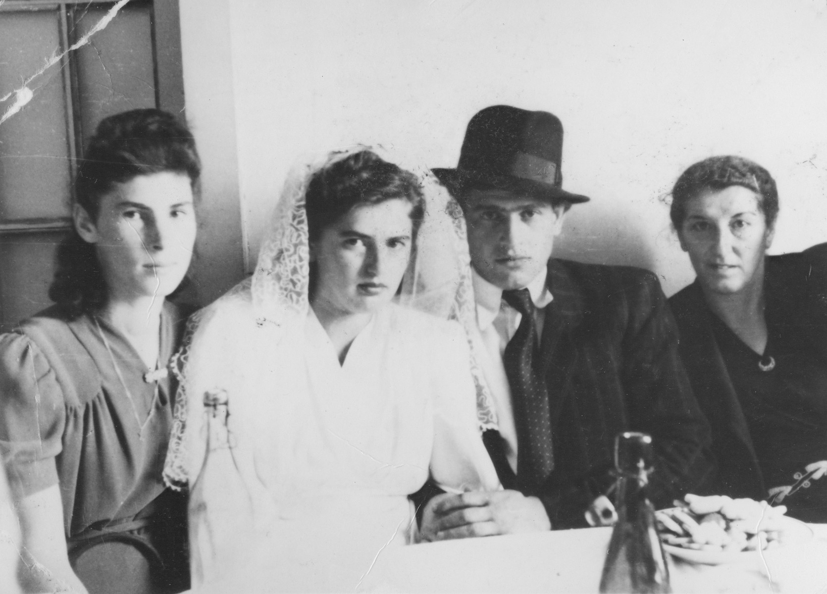 Wedding of Shloyma Turkeltaub and Pepi Breier.    To the right of the couple is the bride's mother, Rose Alter Breier.