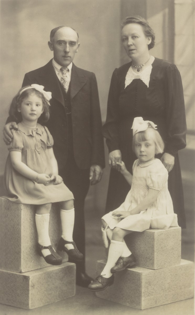 Studio portrait of a Belgian family with the Jewish child they are hiding.  Pictured clockwise from the top left are: Leon and Maria Janssens,Gilberte Janssens and Goldine Ehrenfeld.