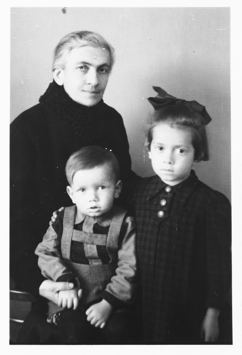 Studio portrait of a Jewish woman with her neice and nephew that she sent to her non-Jewish husband imprisoned in the Jasenovac concentration camp.  Pictured are Giza (Deutsch) Vrancic with Teodora and Zdravko Basch.