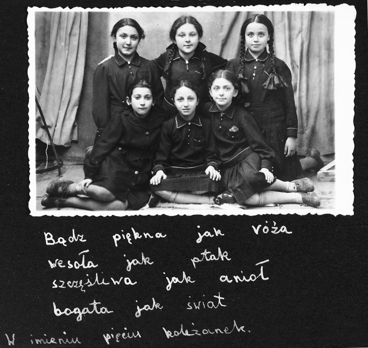 Group portrait of five classmates from the Tarbut school in Luck in their school uniforms.  This photo was part of a going-away album presented to Sara Sztejnsznajd prior to her immigration to the United States.
