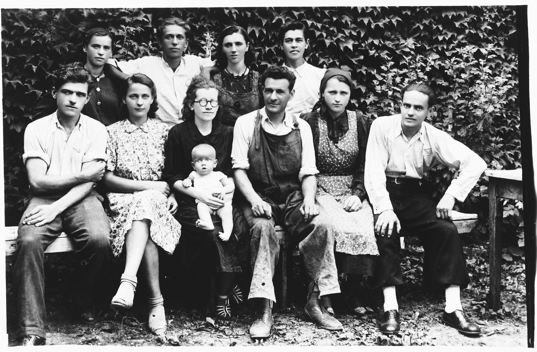 Salamon Basch (third from the right) poses with the employees of his brush making workshop in Zagreb, Croatia.  Also pictured is Silva Basch holding her daughter Teodora.