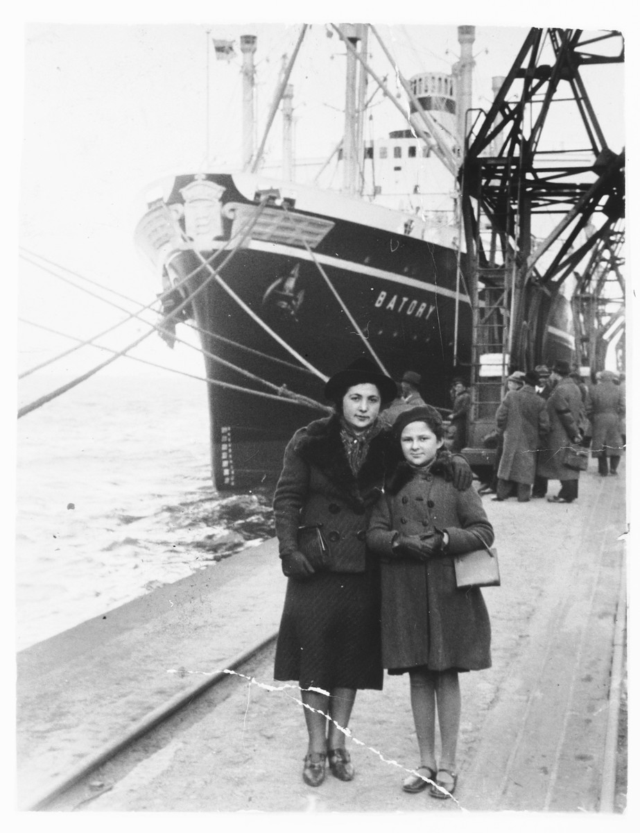 Sara Sztejnsznajd waits with her aunt Peppa Garber in front of the ship, The Batory, prior to her departure for America.