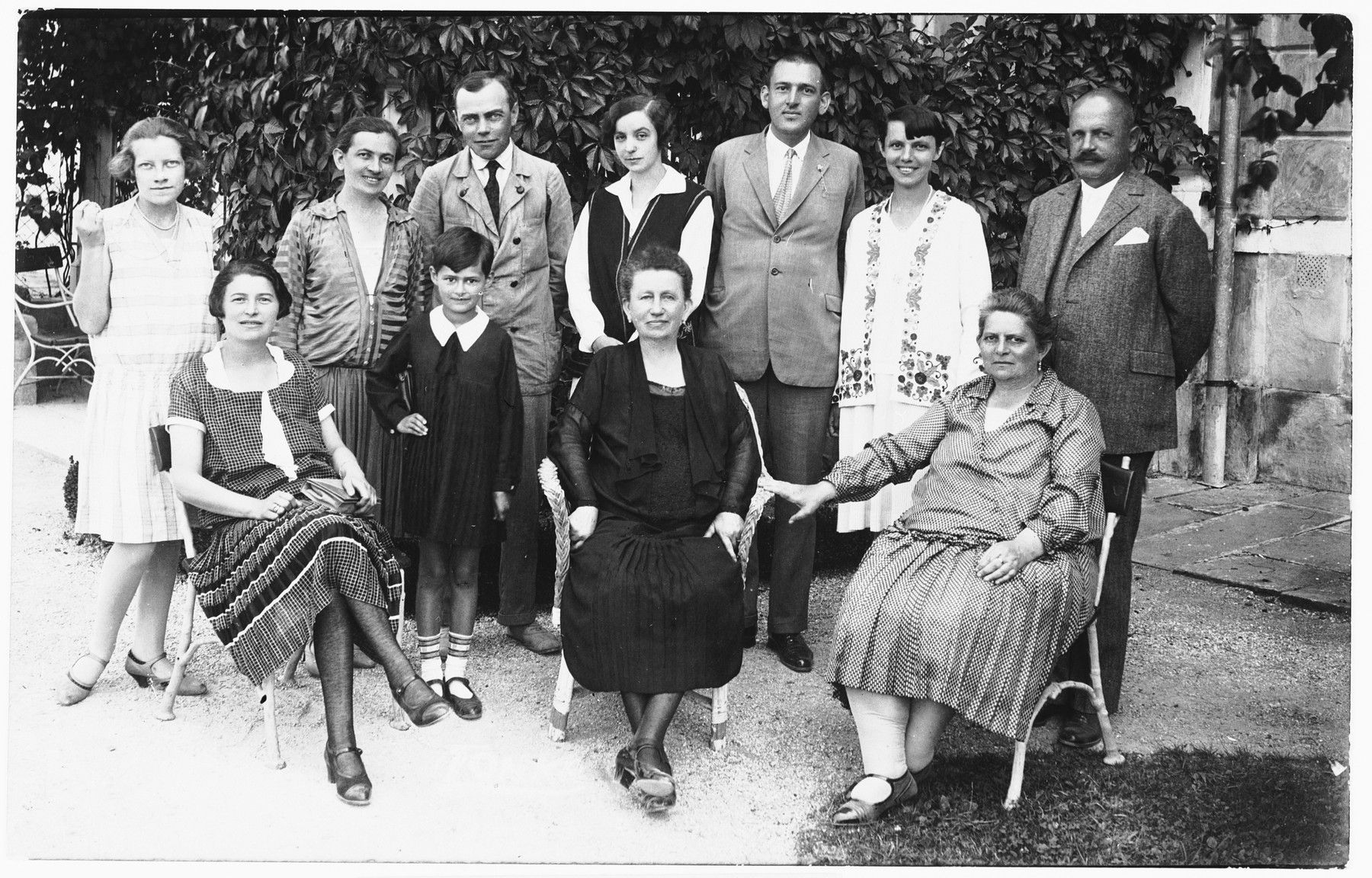 Group portrait of Jewish and non-Jewish friends at a social gathering in Ludbreg, Croatia.  Among those pictured are Silva Deutsch (top row on the far left), Giza Deutsch (top row, second from the left) and Ljudevit (Ludva) Vrancic, Giza's future husband (top row, third from the left).
