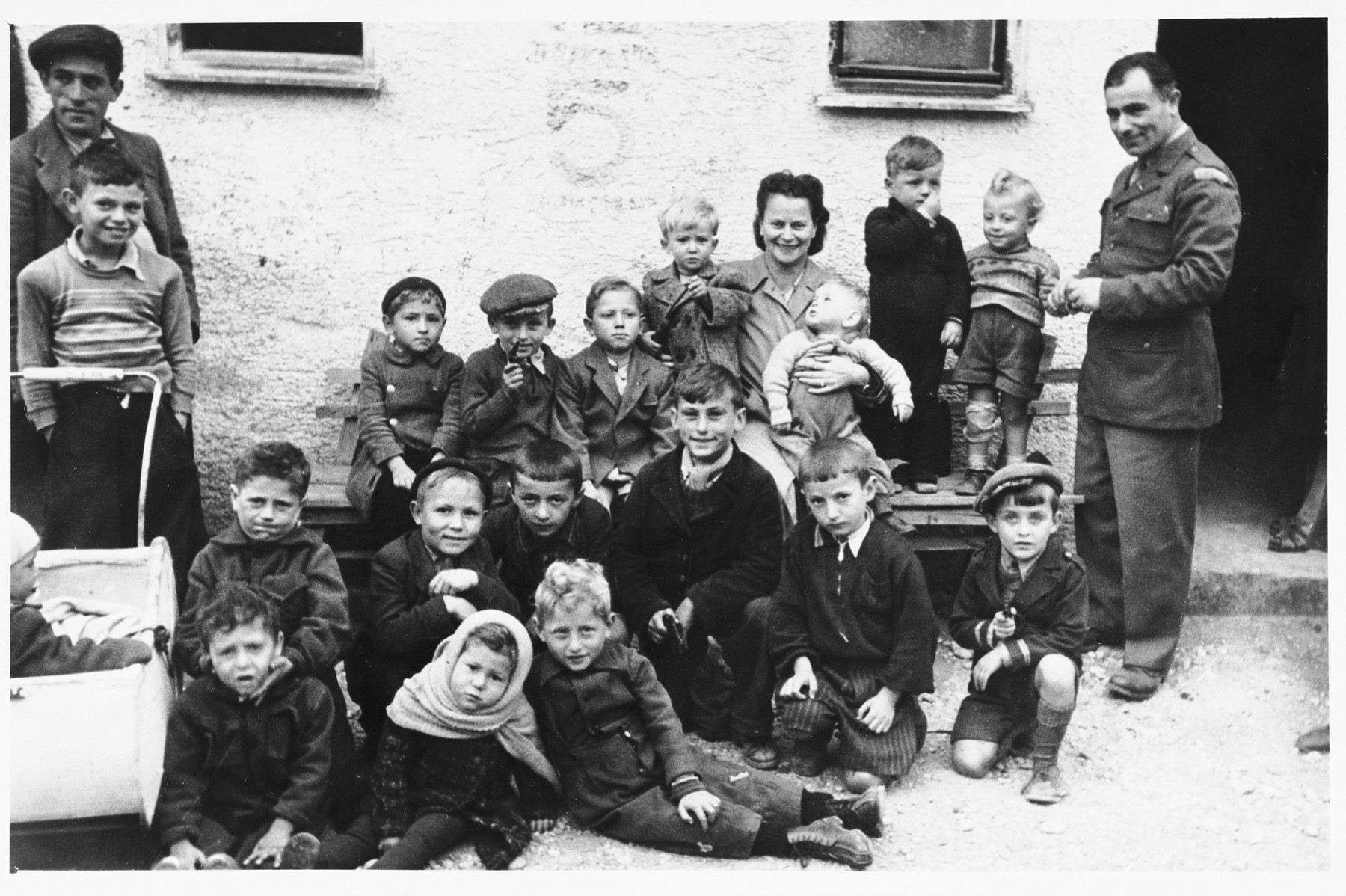 Isaak Libstug visits with the teachers and children in the Foehrenwald orphanage.