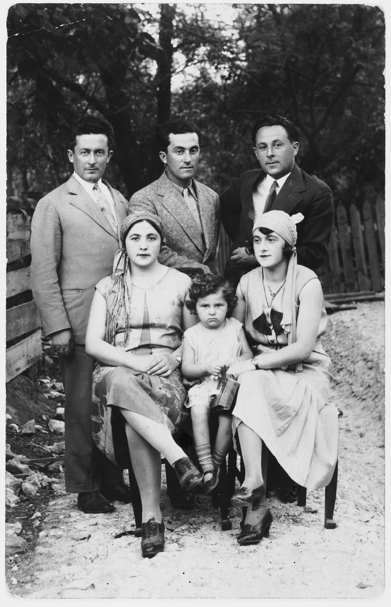 Members of the Garber and Sztejnsznajd families pose outdoors while on a summer vacation at a resort in Poland.  Pictured from row are Peppa Garber, Sara and Goldie Sztejnsznajd.  Back row: Czala Garber, Haim Garber and Josef Sztejnsznajd.