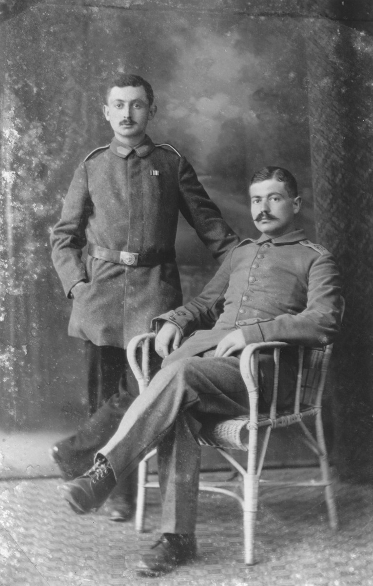 Studio portrait of two German Jewish soldiers during World War I.   The soldiers were cousins of the donor Werner Mendel.