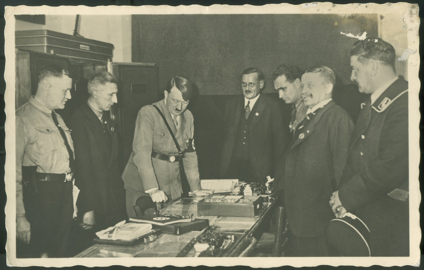 Adolf Hitler and other dignitaries at the opening of the Nazi Party museum in the Sterneckerbraeuhaus, which had been the Party's first headquarters.
