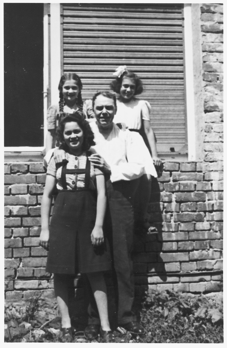 Ljudevit (Ludva) Vrancic poses outside with his three Jewish nieces.  Pictured in front are: Zdenka Apler and Ljudevit (Ludva) Vrancic.  Behind them are Vera Apler and Edita Deutsch.