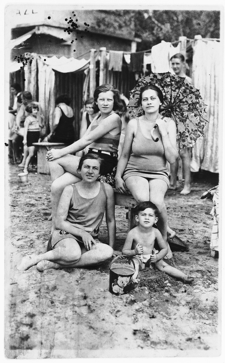 Three Jewish sisters on an outing to the beach.  Pictured in front are Giza Deutsch (left) and Zdenka Apler (child).  Standing behind them are Silva Deutsch (left) and Blanka (Deutsch) Apler.