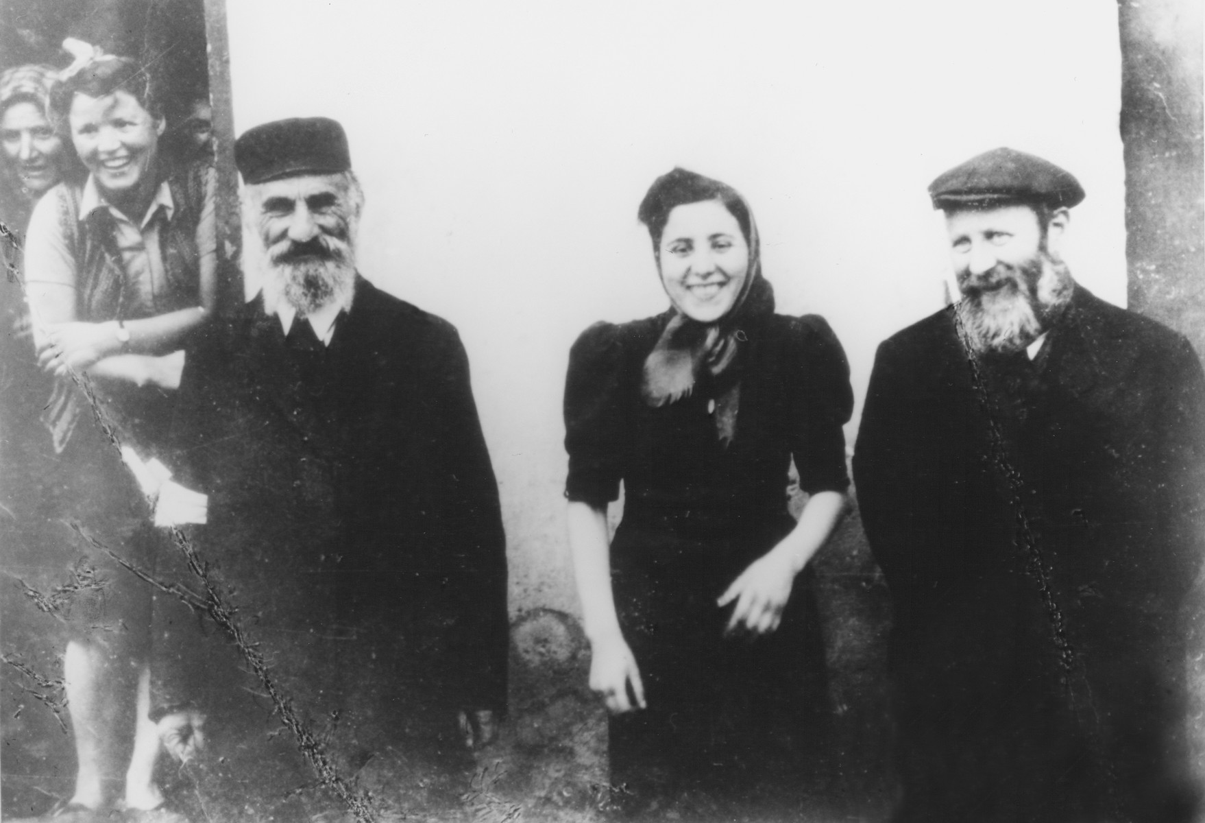 Members of the Gelbfisz family in the Siedlce ghetto.  Pictured on the far right is Shlomo Yosef Gelbfisz.  Next to him is his daugher Esther.