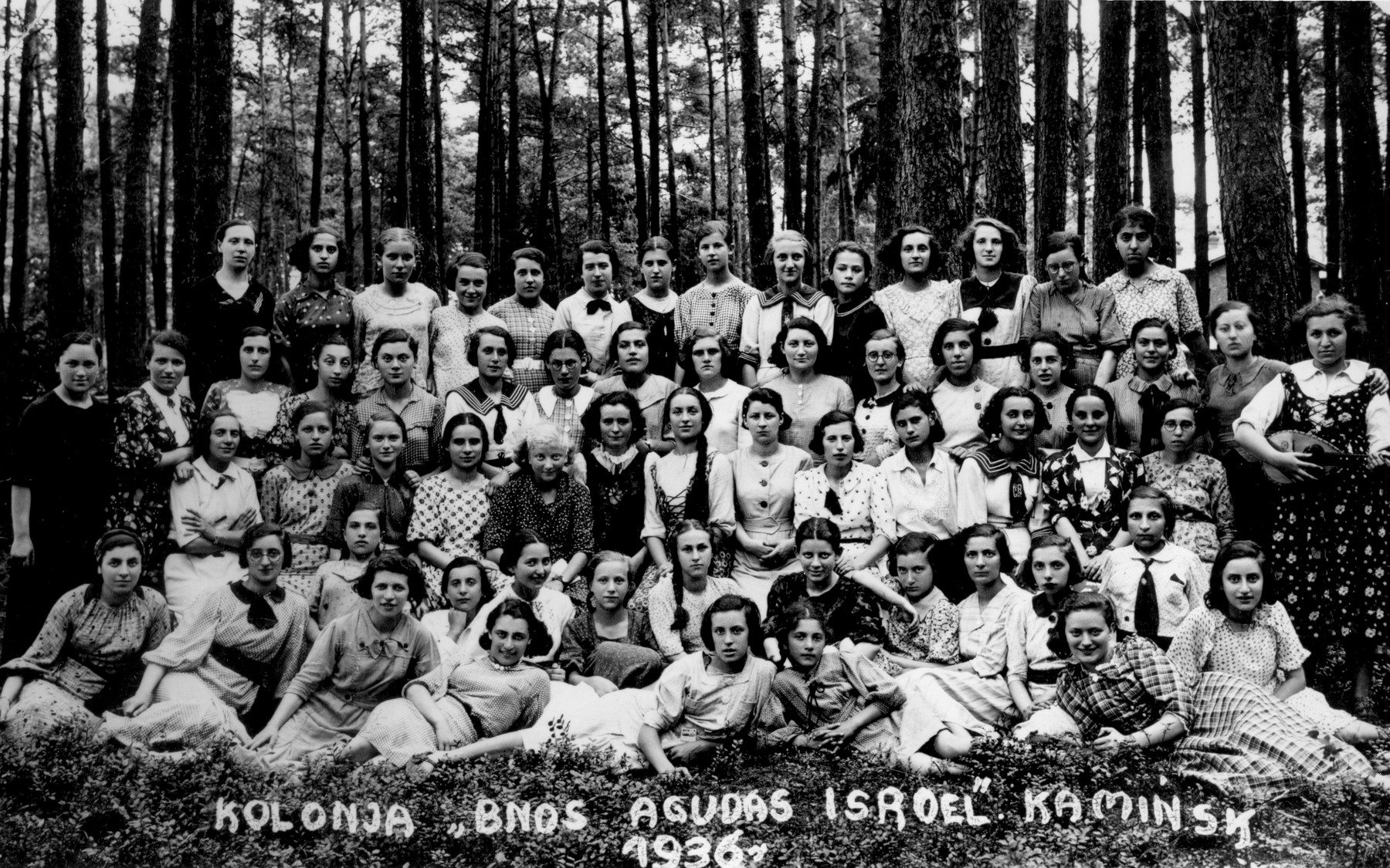 "Group portrait of students from the Beit Yaakov, religious school for girls in Bedzin at the ""Bnot Agudat Yisrael"" (Agudat Yisrael girls) summer camp in Kaminsk.    Among those pictured is Machela Cukierman (front row, second from the left) and Hadasa Broder (third row from the front, fourth from the left)."