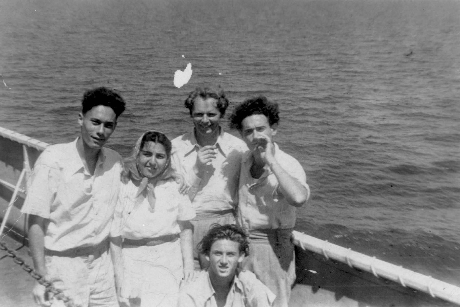 John Stanley Grauel poses on the deck of the SS Marine Carp with friends and fellow journalists, while on his way back to the United States after serving on the crew of the Exodus 1947.
