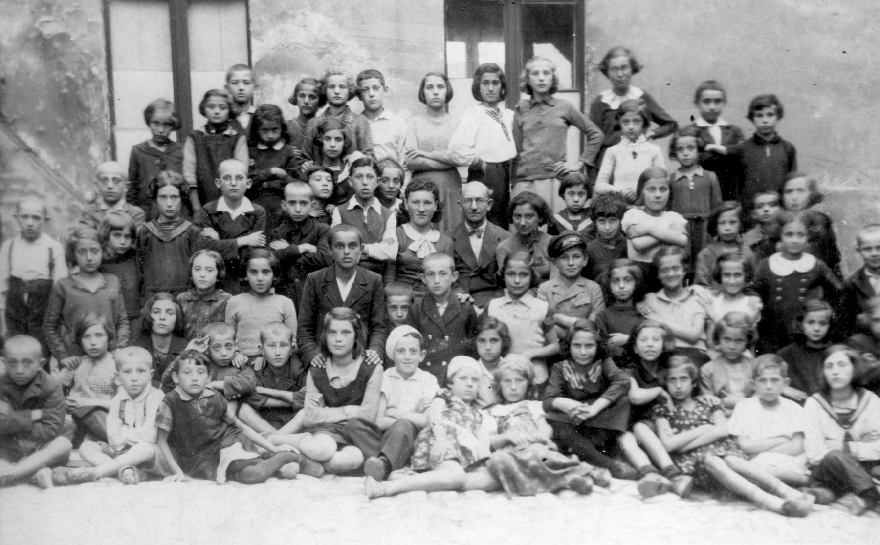 Group portrait of children at a summer day camp in Bedzin.    Among those pictured is Abram Szyjewicz (first row, center, wearing a light shirt and beret) and his sister Laja (not identified).