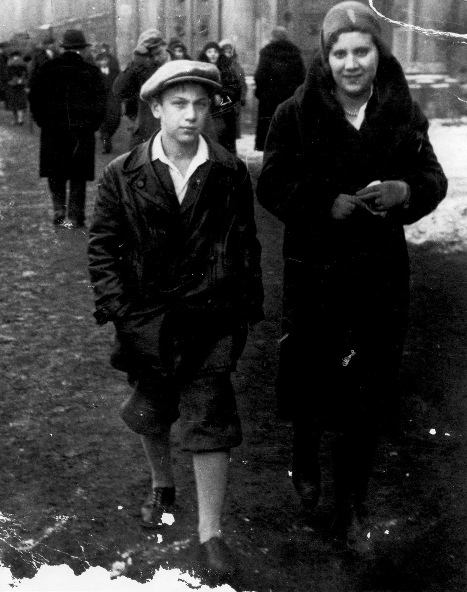 Two Jewish siblings walk along a street in Krakow.  Pictured are Elek (Dan Elias) and Rosa Laufer.