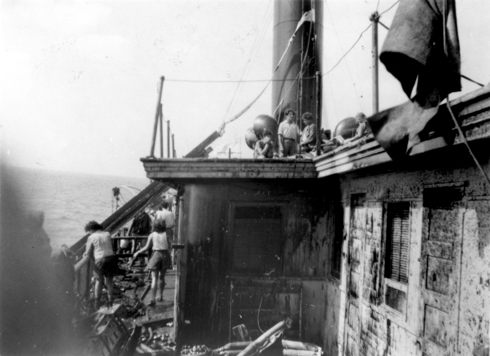Exodus 1947 passengers survey the damage the morning after the battle with the British boarding party.
