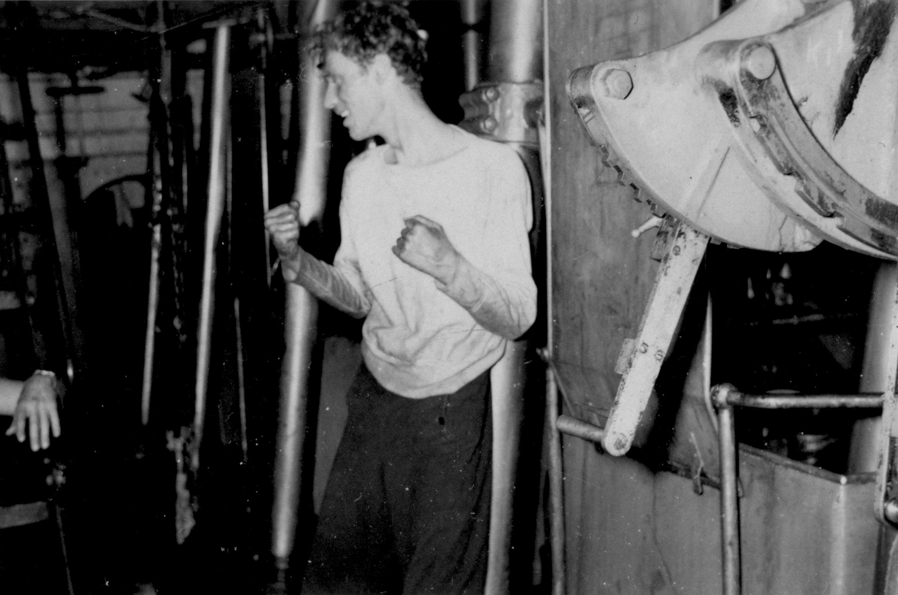 Paul Yarin of Boston stands in the flooded engine room of the President Warfield after the gale that nearly sank the ship during its first attempt to cross the Atlantic Ocean.  After the ship returned to port following the storm, Yarin left the ship due to illness.  It was a very severe case of rheumatoid arthritis. He spent two years in a VA hospital (he was a WWII Coast Guard vet). He died in 1965 at age 38.