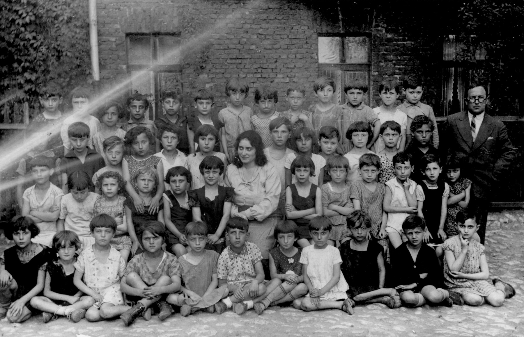 Group portrait of students and their teachers at a Jewish elementary school in Bedzin.