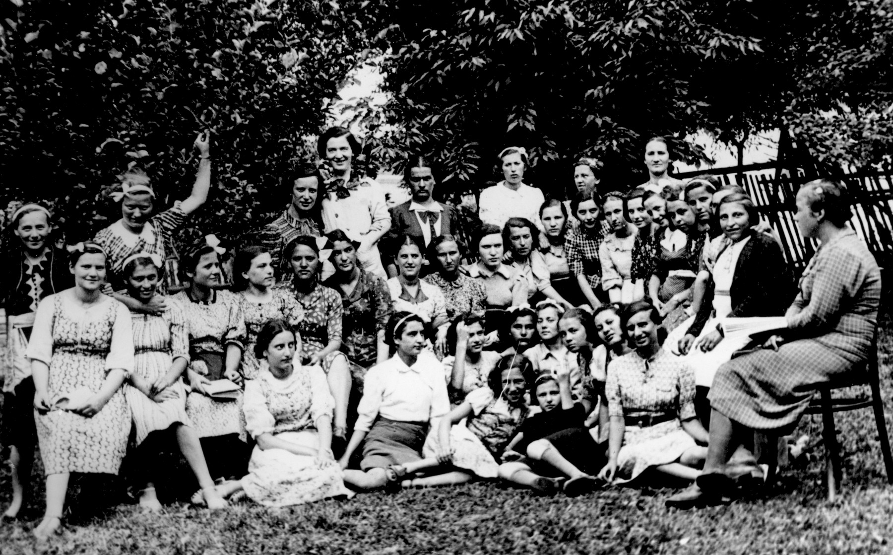 "Group portrait of students from the Beit Yaakov religious school for girls in Bedzin [probably at the ""Bnos Agudas Isroel"" summer camp in Kaminsk].    Among those pictured is Bala Zajonc."