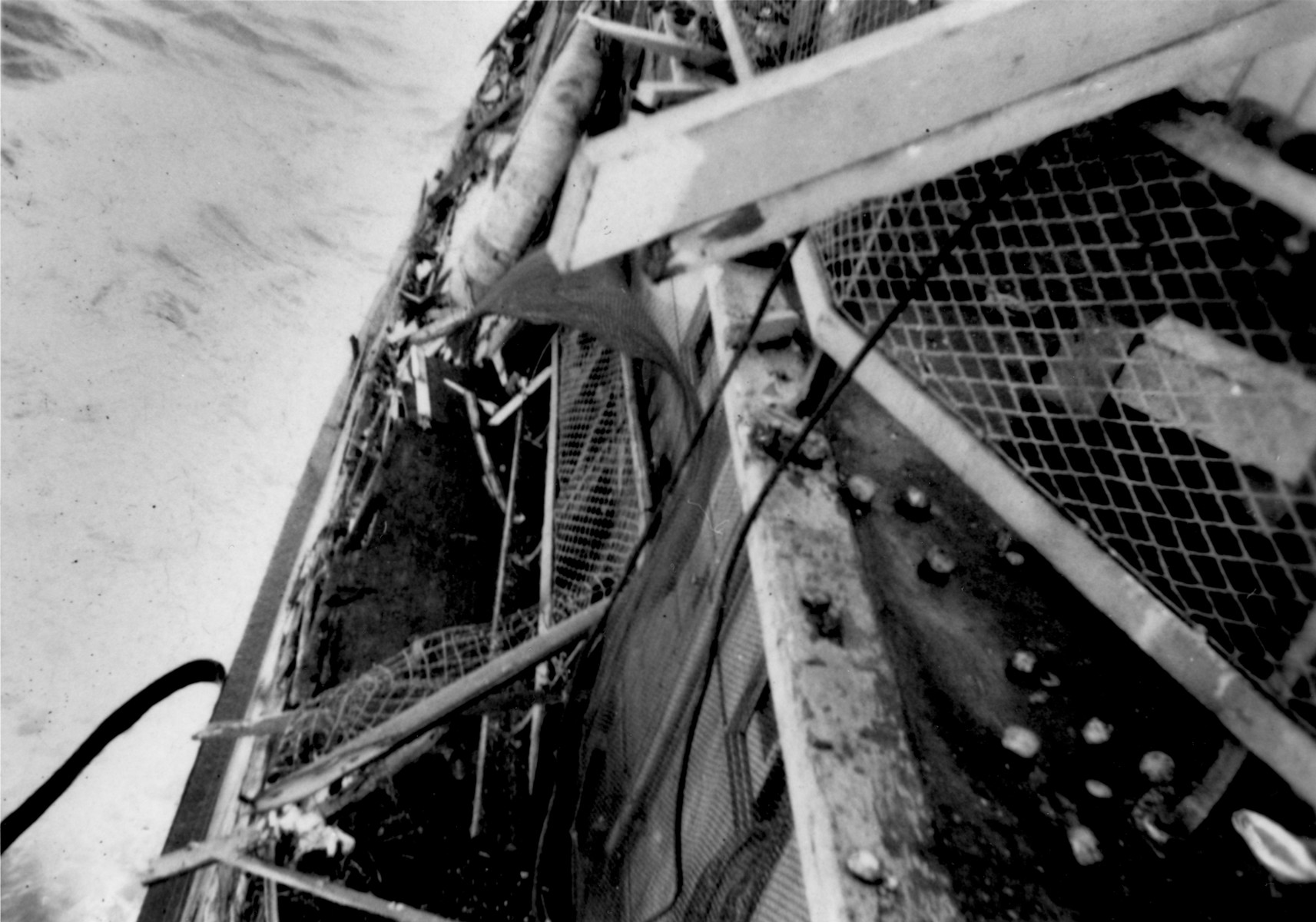 View of the heavily damaged port side of Exodus 1947 illegal immigrant ship after being rammed by a British destroyer during its interception off the coast of Palestine.