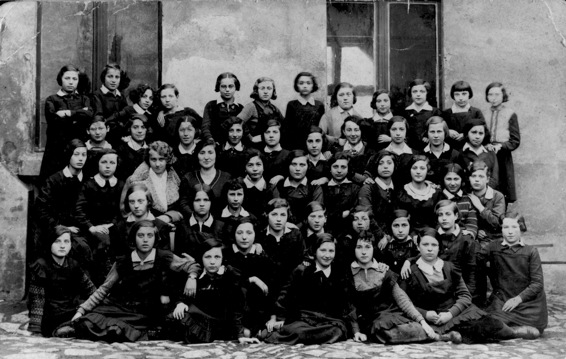 Group portrait of students of the Beit Yaakov religious school for girls in Bedzin.    Among those pictured is Laja Szyjewicz.