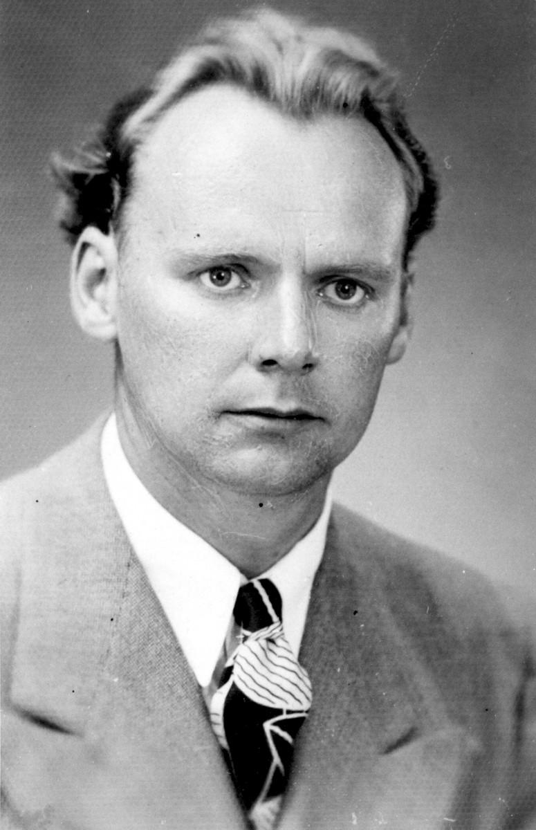 Studio portrait of Exodus 1947 crew member John Stanley Grauel.