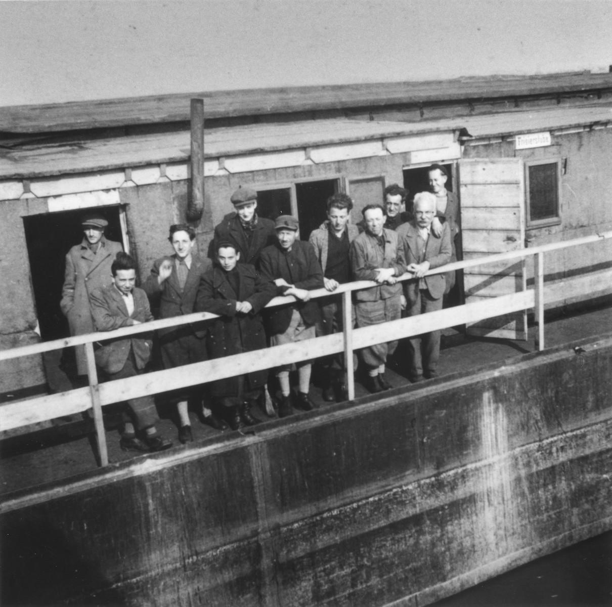 Jewish refugees who are members of the Kladova transport, stand on the deck of a barge in the port of Kladova.  Among those pictured is Walter Fink, the uncle of the donor.