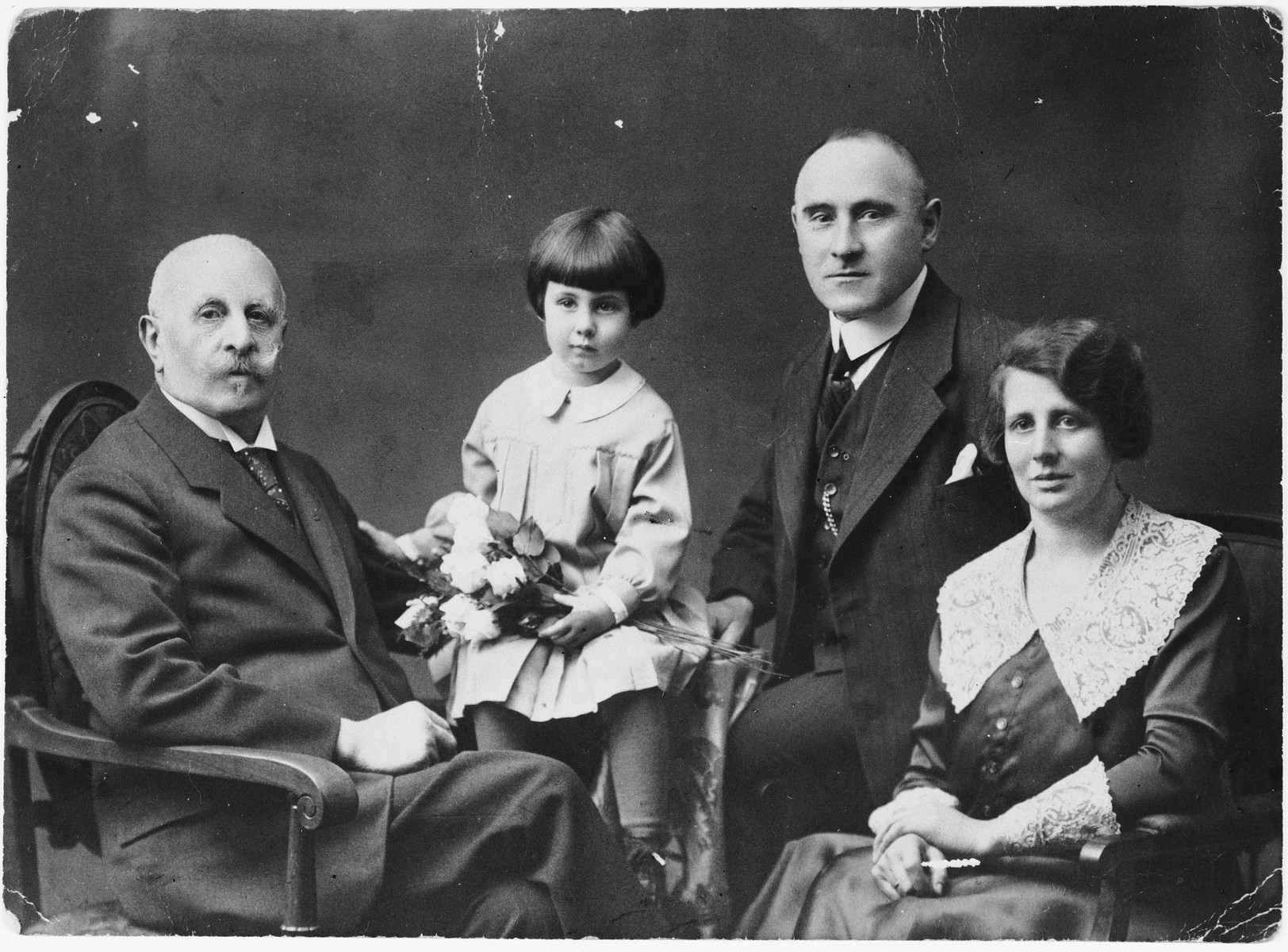 Studio portrait of a Jewish family in Stettin, Germany.  Pictured from left to right are: Max Berndt, Ilse Wulff, Herman Wulff, and Lotte (Berndt) Wulff.