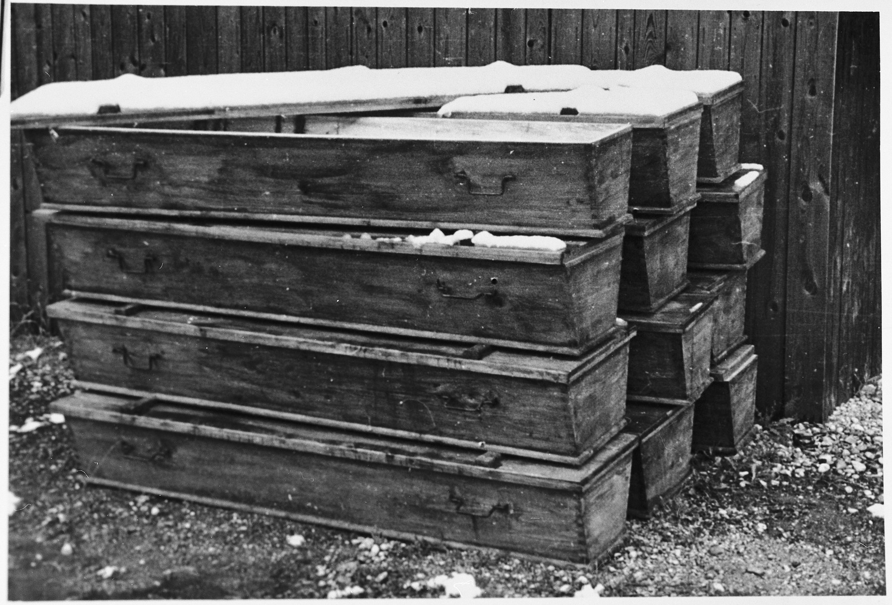 Postwar view of a pile of coffins in the Dachau concentration camp.