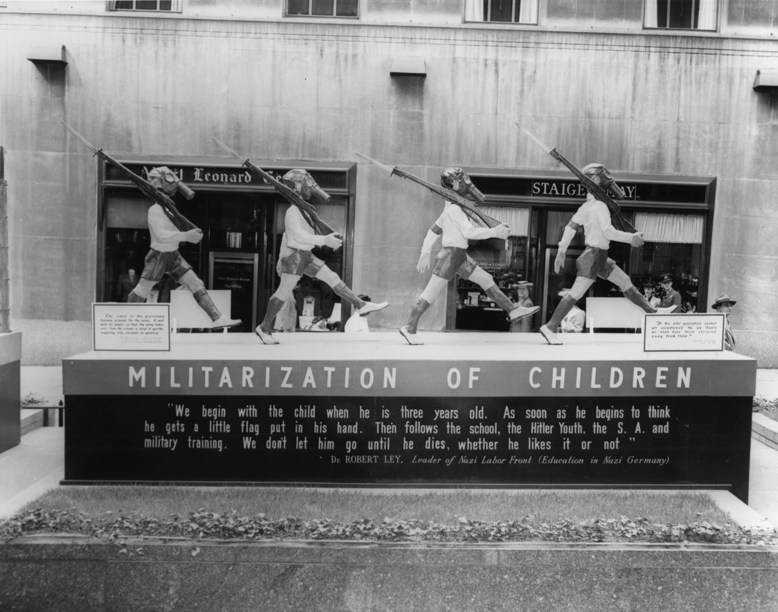 "View of the tableau entitled ""Militarization of Children"" part of the  ""The Nature of the Enemy"" exhibition at Rockefeller Plaza in New York city.    The display depicts the enemy's conception of a child's education."