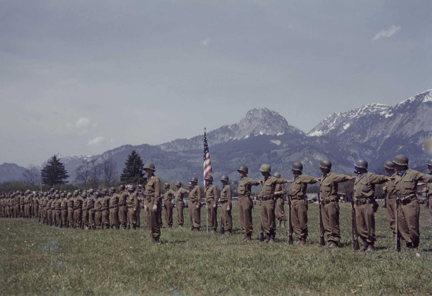 Members of the U.S. 9th Armored Division meet up with units of the Red Army near Linz, Austria.