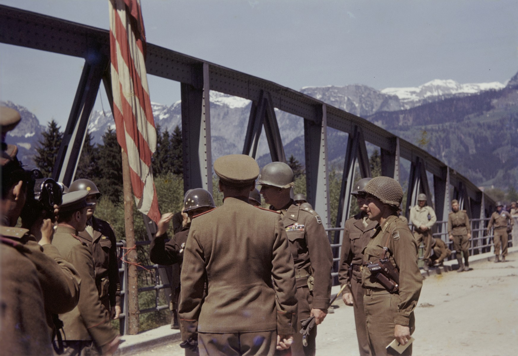 Members of the U.S. 9th Armored Division meet up with units of the Red Army near Linz, Austria.  Pictured is the Roethelbruecke Bridge over the Enns River, between Liezen and Selzthal.