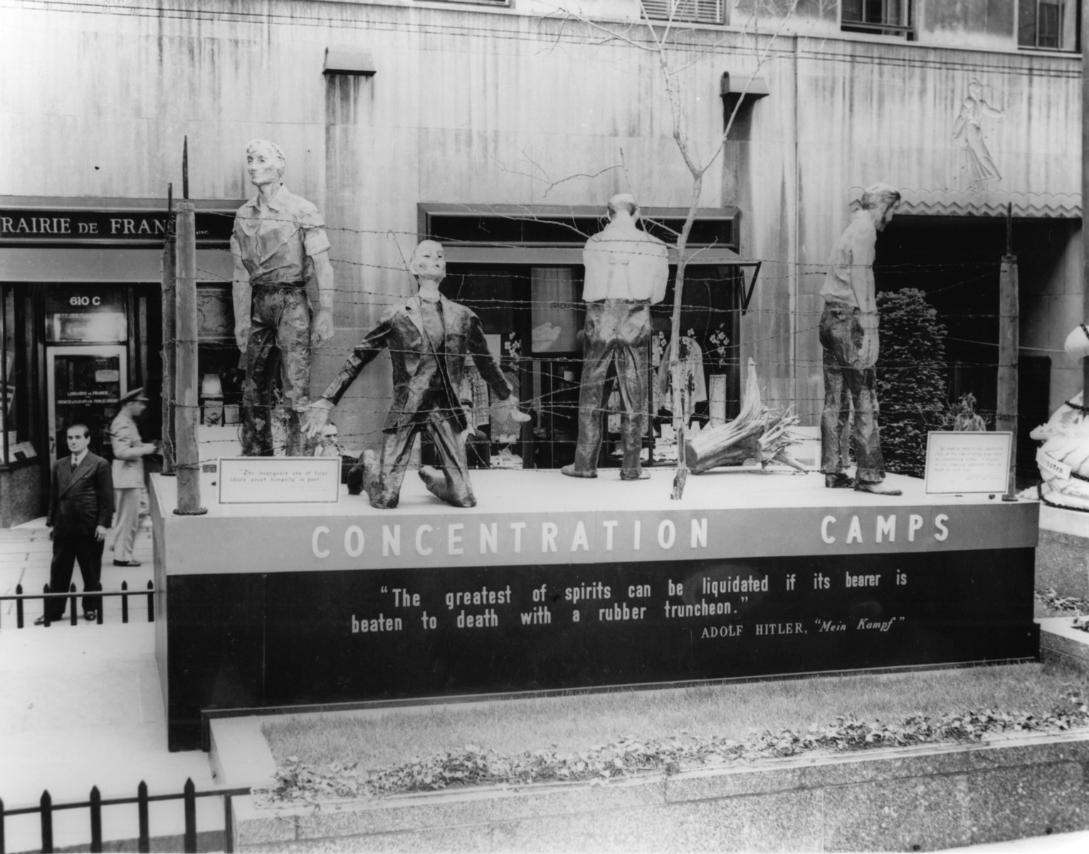 "View of the tableau entitled ""Concentration Camps"" at ""The Nature of the Enemy"" exhibition.  The display depicts the enemy's treatment of its opponents."