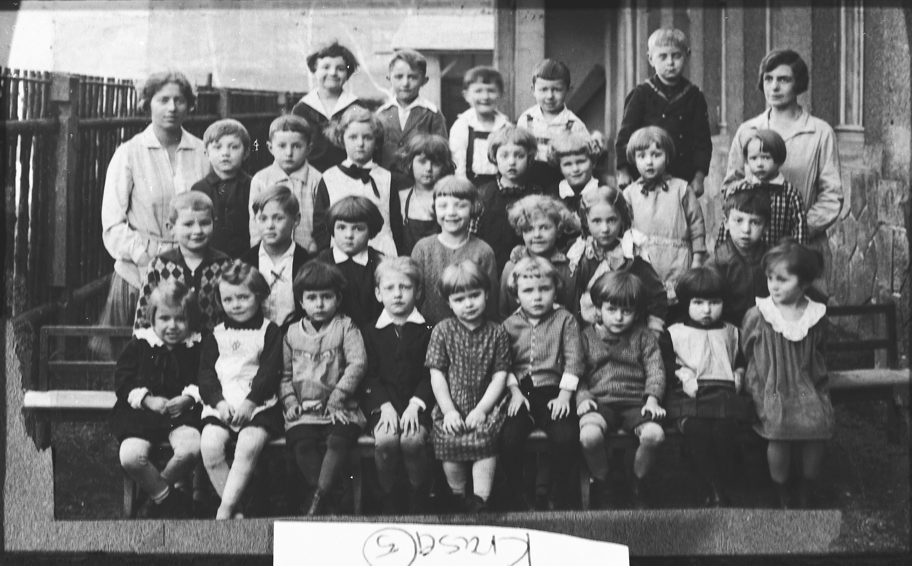 Group portrait of Czech and Jewish pupils in an elementary school in Prague.  Among those pictured is Edgar Krasa (second row from the front, second from the left).