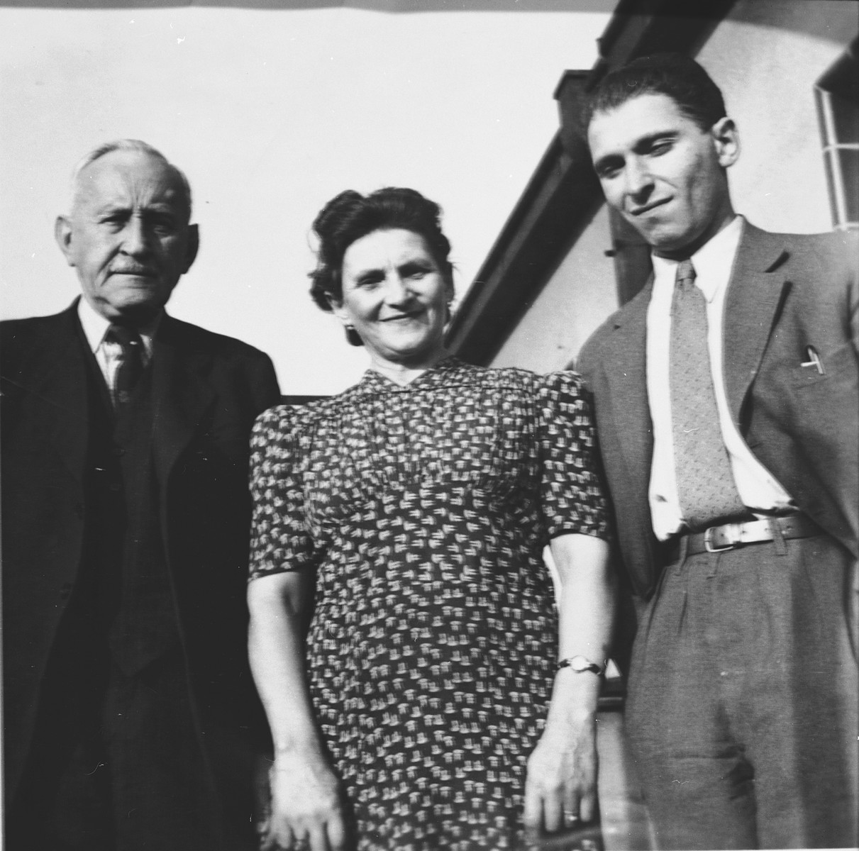 Alois and Elsa Krasa pose on the balcony of their home in Prague with Josef Svehla (Schwartz), a friend of their son, Edgar.  Edgar Krasa credits Josef Svehla with saving his life in Gleiwitz by giving him extra bread.  Josef had served as the cook in the SS kitchen.