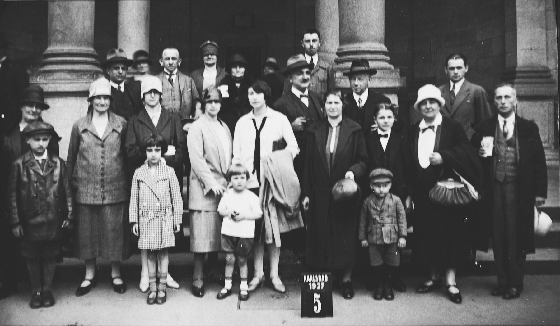 Group portrait of Czech Jews vacationing in the Karlsbad spa.  Pictured in the center are Elsa Krasa and her sister, Rosa Feldstein.  In front of them are their children Olga Feldstein and Edgar Krasa.