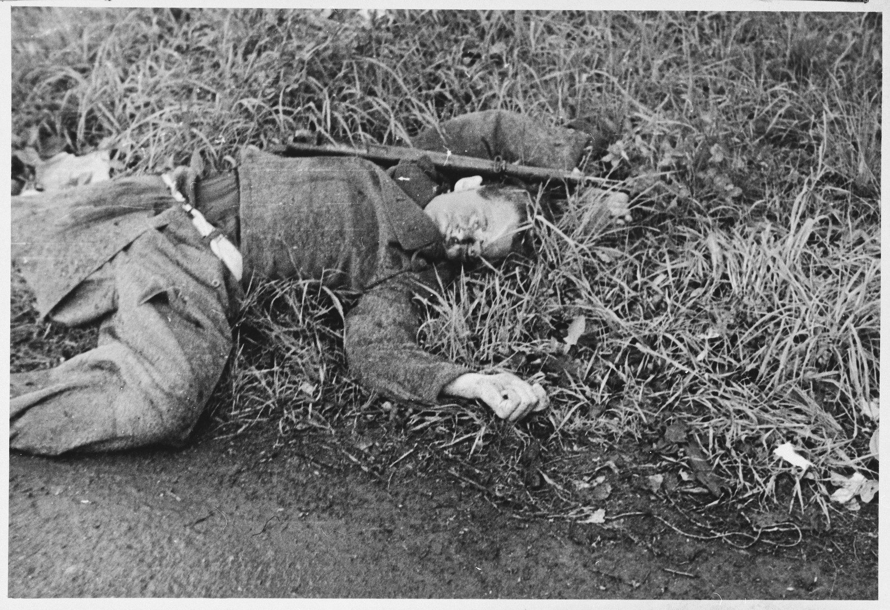 Close-up view of the corpse of an SS guard murdered in a revenge killing in the Dachau concentration camp.